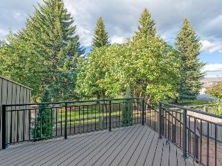 Backing onto private picturesque green space.