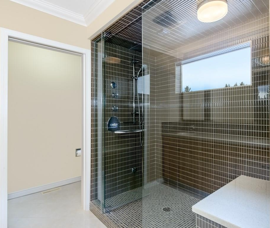 Ensuite with spectacular steam shower with bench.