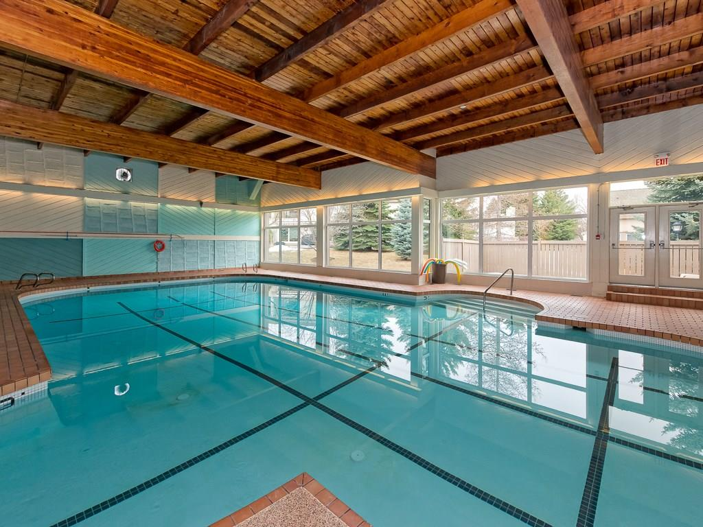 Amenities include an outdoor tennis court, workout room and indoor pool.