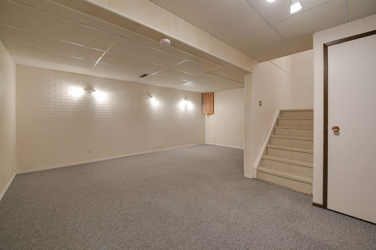 The basement includes a laundry and large rec area perfect for hanging out.