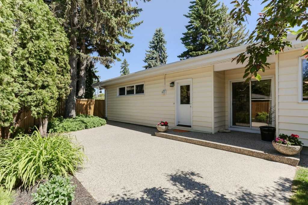 Back yard has an exposed aggregate concrete patio. Access to the family room through double patio door or the man door that leads to the mud room.