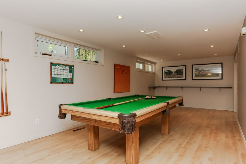 Games room set up with a pool table. Endless possibilities for this room