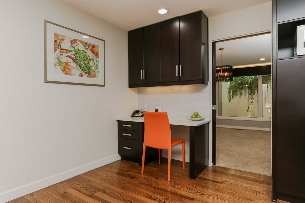 Built in desk by breakfast nook area, perfect for checking emails or kid's homework.