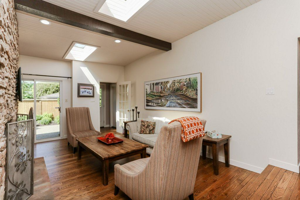 Family room off the kitchen has a wood burning fireplace finished with stacked stone. Lots of natural light comes in from the 2 skylights above the family room.