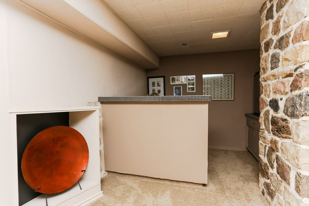 2nd family room in the basement has a wood burning fireplace, wet bar and beverage fridge.