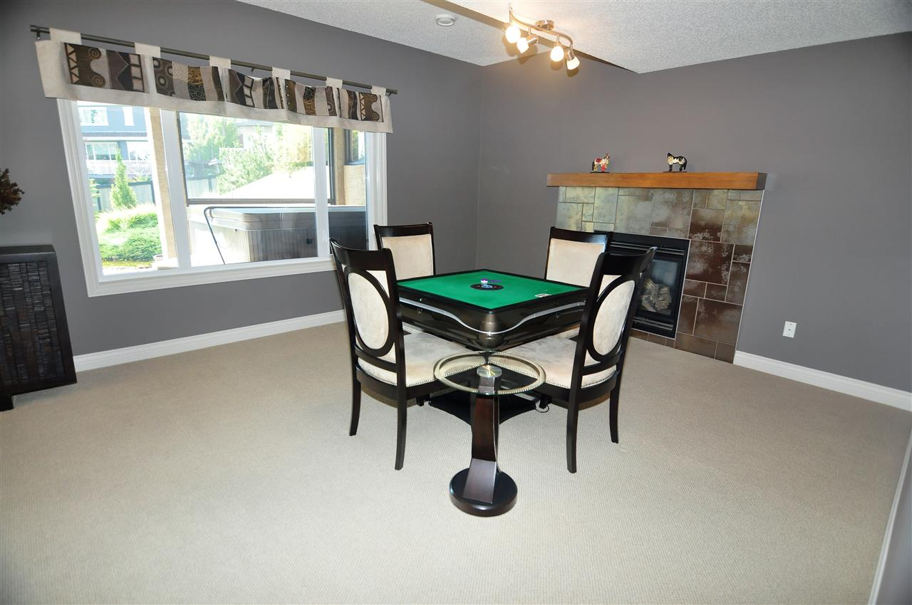 Games room or family room with cozy gas fireplace.