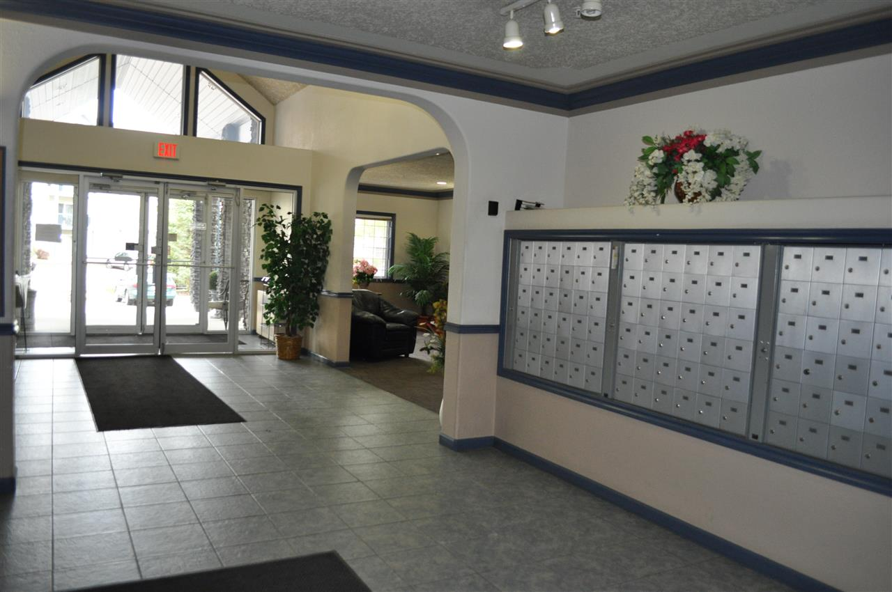 The lobby is bright and inviting, with a security door, and ample visitor parking, right at the front door