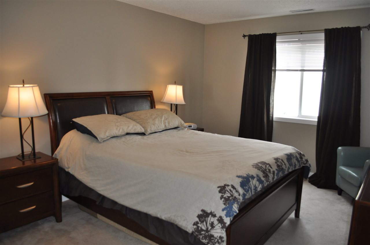 The master bedroom is a large room, with space enough for large furniture