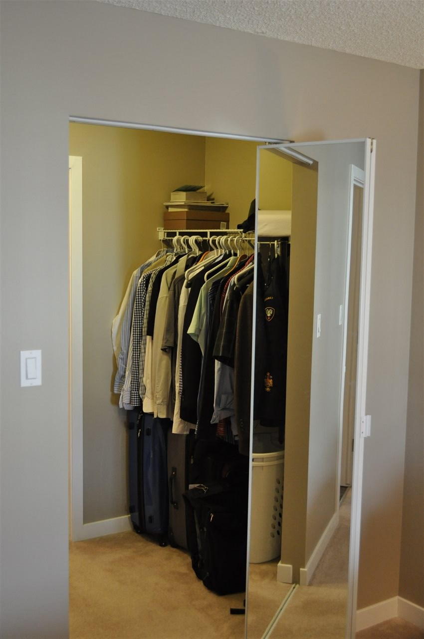 The double walk through closet is large, and vanishes behind a set of glass bifold doors