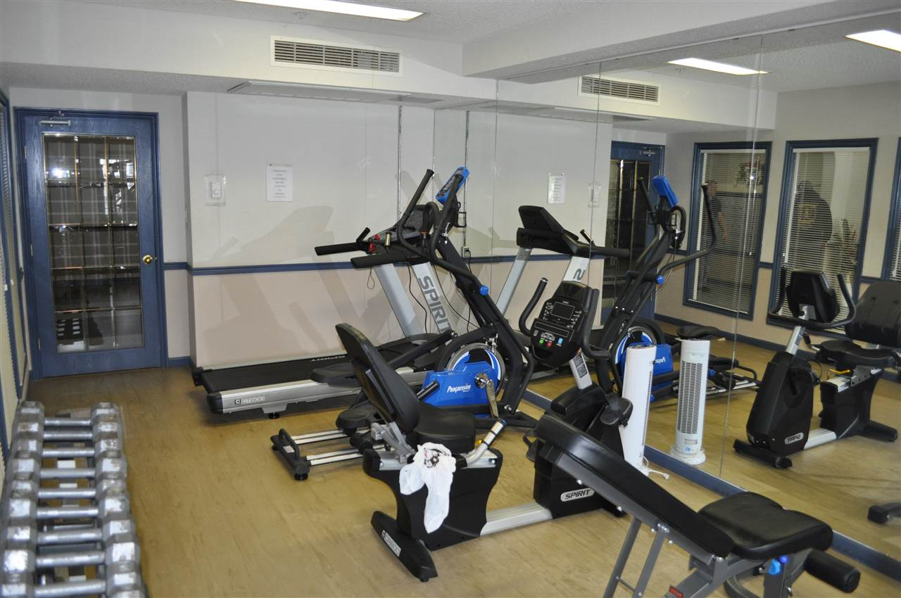 The fully equipped gym is located off of the lobby
