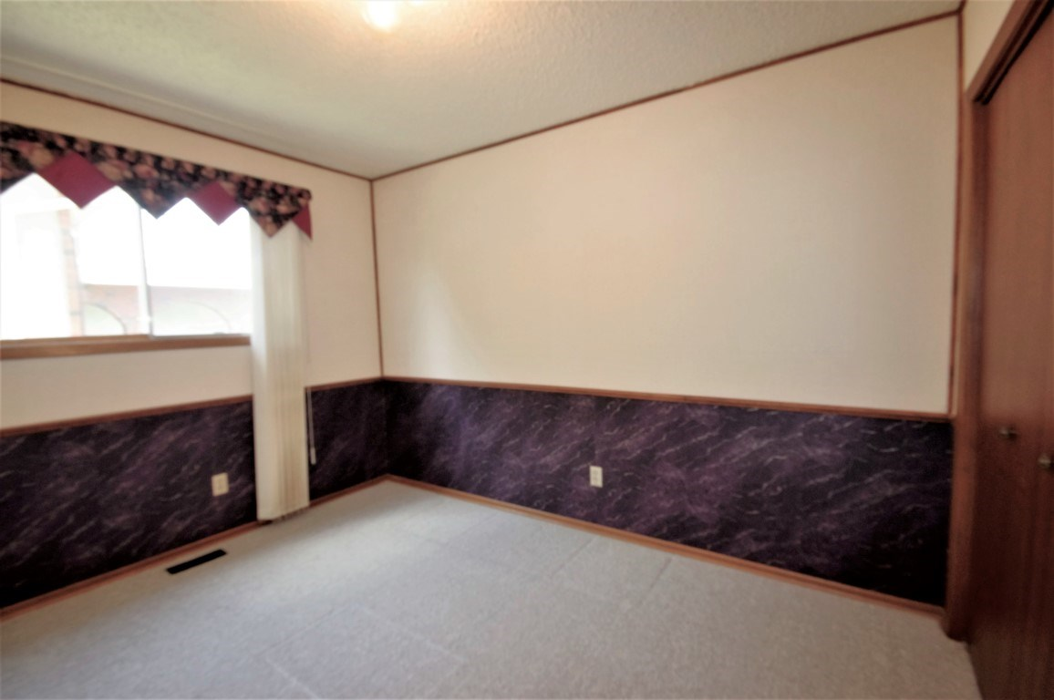 Main floor office/den or bedroom, next to full washroom and perfect for anyone needing a main floor bedroom.