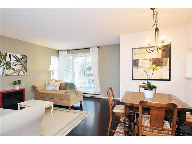 "Main Photo: 106 1845 W 7TH Avenue in Vancouver: Kitsilano Condo for sale in ""HERITAGE AT CYPRESS"" (Vancouver West)  : MLS®# V871069"