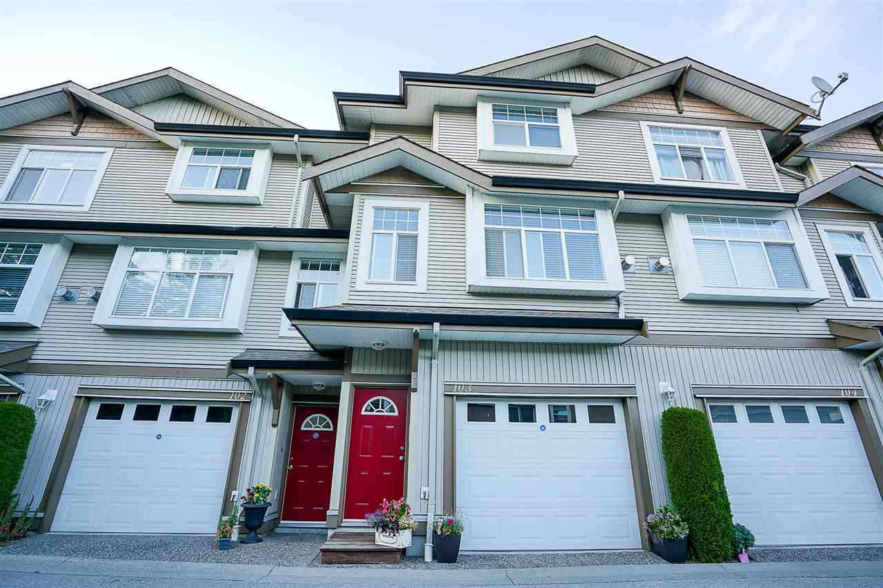 "Main Photo: 103 9580 PRINCE CHARLES Boulevard in Surrey: Queen Mary Park Surrey Townhouse for sale in ""Brittany Lane"" : MLS® # R2196574"
