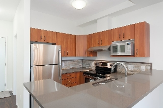 "Main Photo: 404 20200 56 Avenue in Langley: Langley City Condo for sale in ""The Bentley"" : MLS®# R2116212"