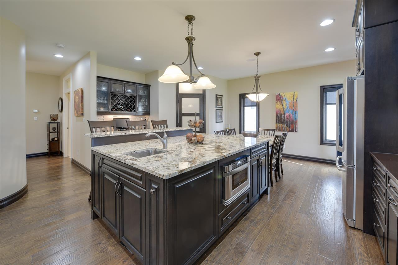 The gourmet kitchen will inspire every chef with custom cabinets, granite and quartz counters, professional grade stainless appliances, walk through pantry plus a built in table.