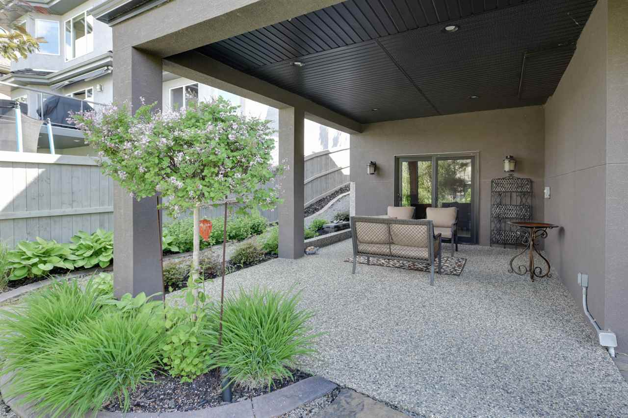 Lovely patio looking out onto the professionally landscaped yard and walking path.