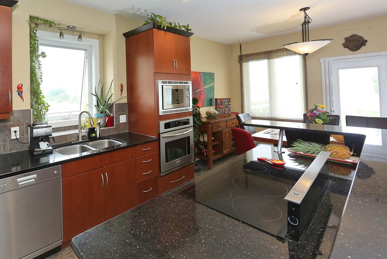The kitchen has a nice view of the lake. Also it is an open concept for your family and friends gatherings.