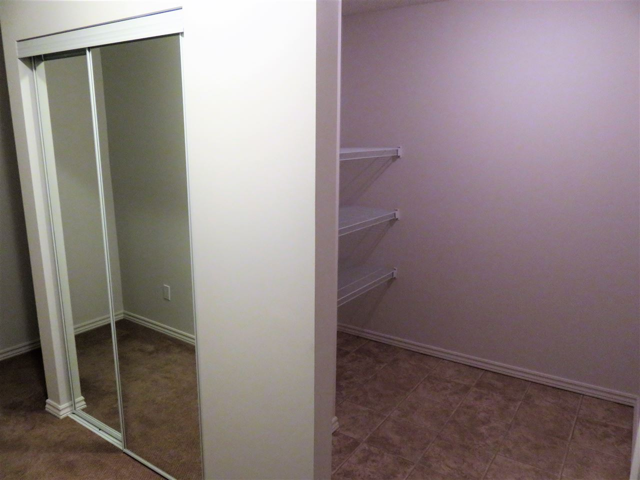 View of the front mirrored closet & storage room located at the entrance to the unit! :)