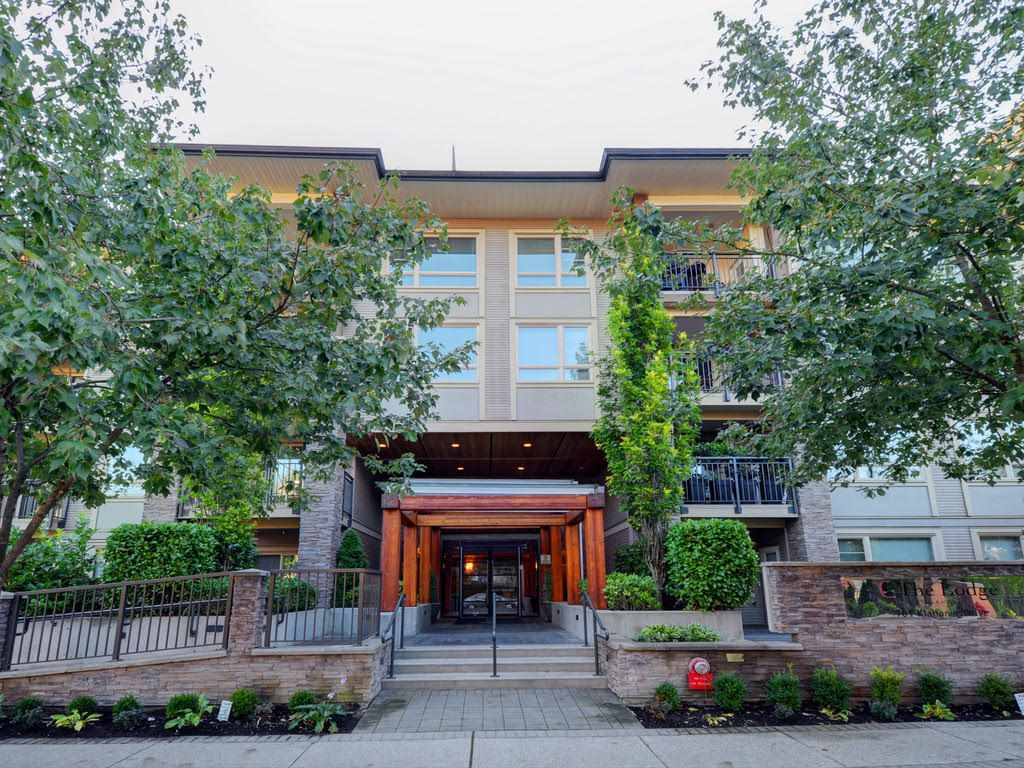 "Main Photo: 104 701 KLAHANIE Drive in Port Moody: Port Moody Centre Condo for sale in ""Nahanni"" : MLS® # R2209103"