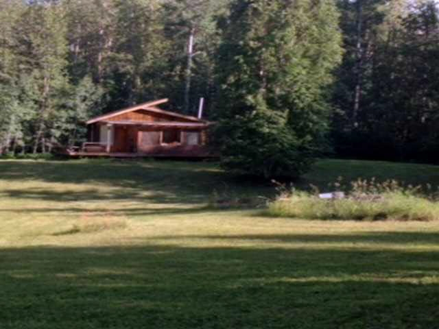 57.86 acres, zoned Recreational with a creek running thru and a small cabin.