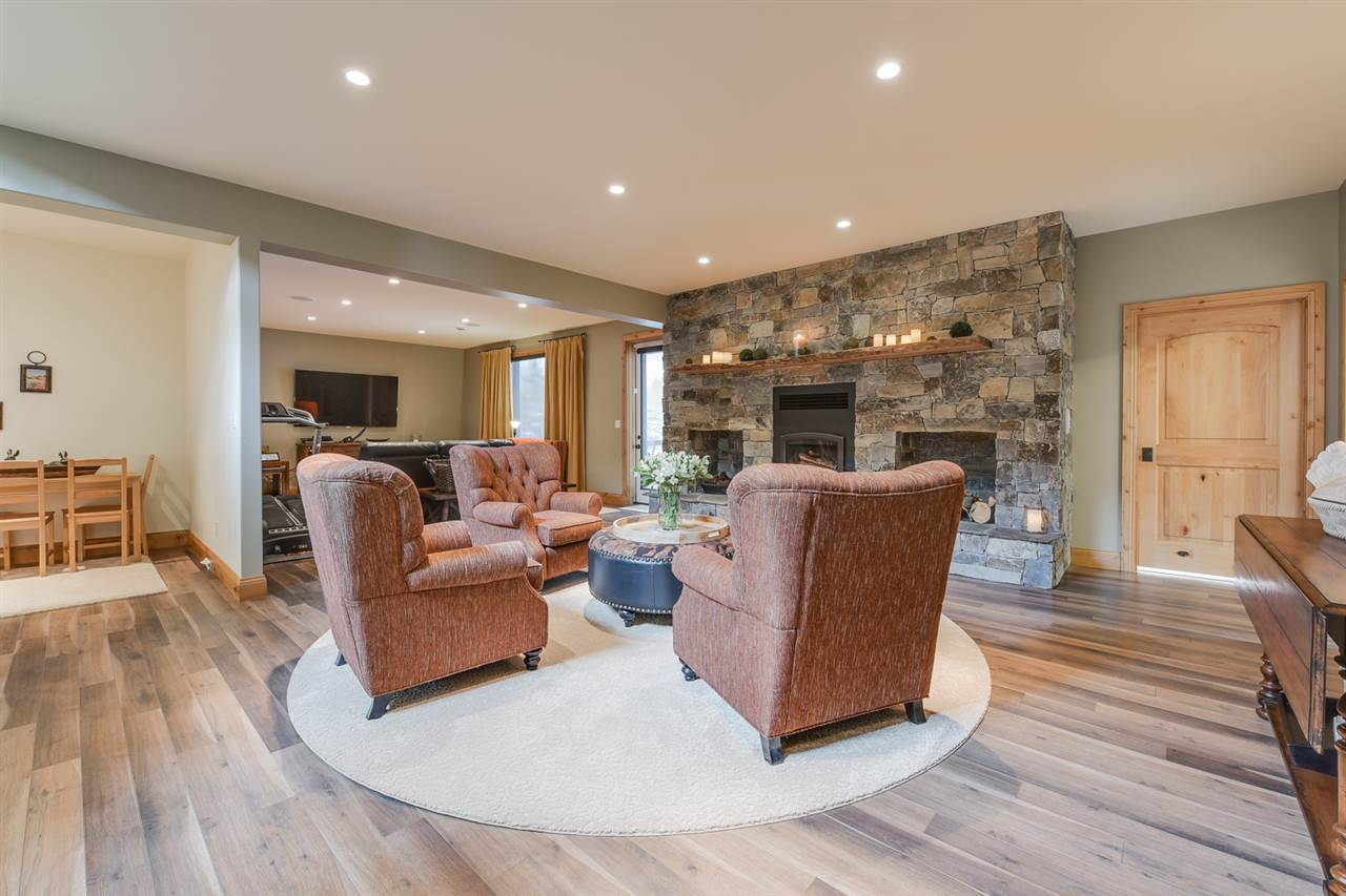 Fully finished basement with 9' ceilings, wood burning fireplace, wet bar, a den, 2 more bedrooms, a full bath and 2 walk out patio.