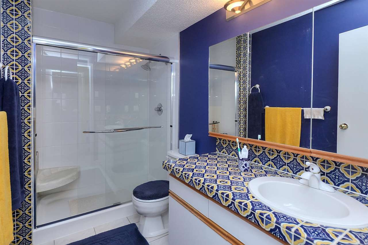 The ensuite features a newer double shower & ceramic tiled vanity & flooring.