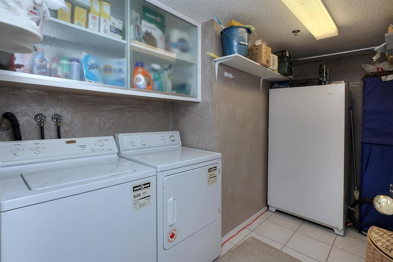 The combined laundry/storage space is very large and it offers ceramic tile flooring.