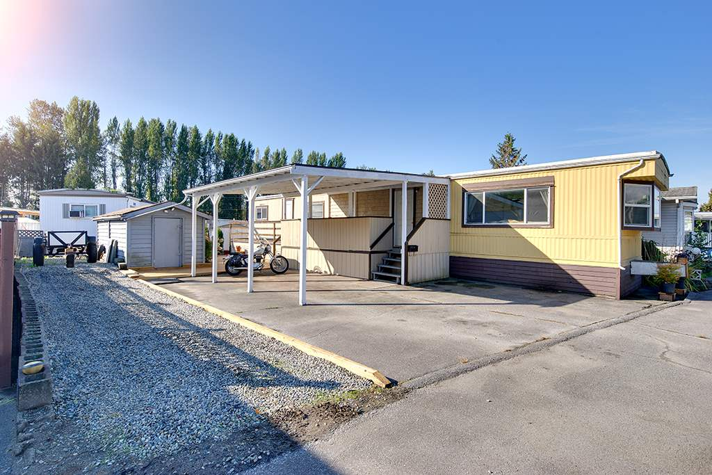"Main Photo: 100 201 CAYER Street in Coquitlam: Maillardville Manufactured Home for sale in ""WILDWOOD PARK"" : MLS®# R2309081"
