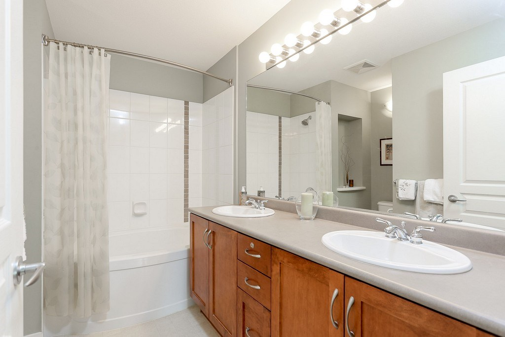 "Photo 13: 404 2958 WHISPER Way in Coquitlam: Westwood Plateau Condo for sale in ""SUMMERLIN"" : MLS® # R2195414"