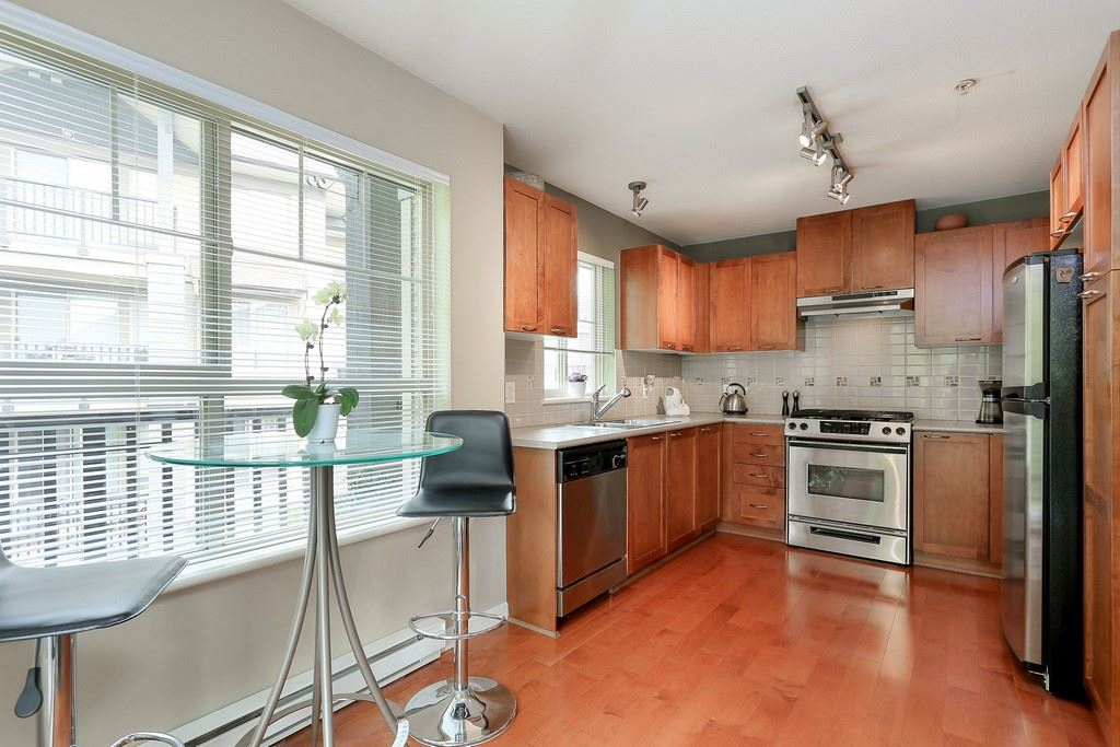 "Photo 6: 404 2958 WHISPER Way in Coquitlam: Westwood Plateau Condo for sale in ""SUMMERLIN"" : MLS® # R2195414"