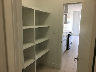 walk through pantry with shelves on both sides