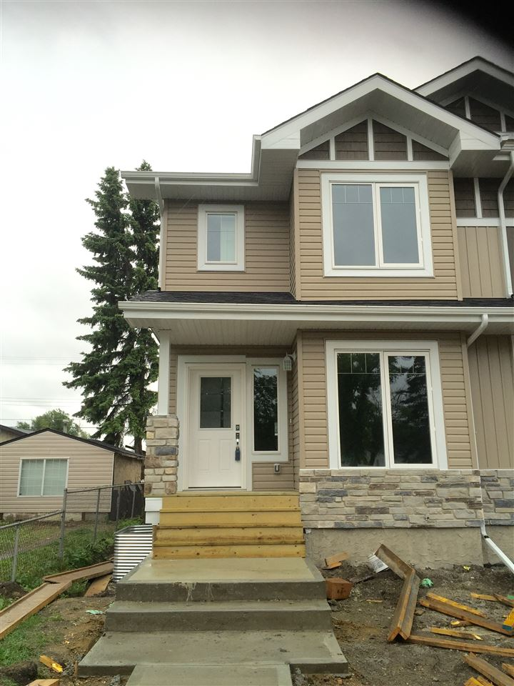 Main Photo: 15501 95 Avenue in Edmonton: Zone 22 House Half Duplex for sale : MLS® # E4068414