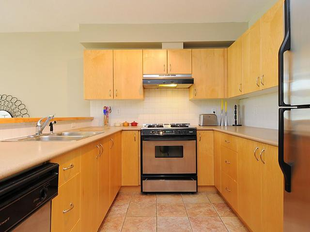 Photo 2: # 104 980 W 22ND AV in Vancouver: Cambie Condo for sale (Vancouver West)  : MLS(r) # V1019648