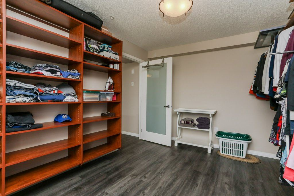 Huge walk -in closet has plenty of room for all your wardrobe needs plus it's been upgraded with California Closet shelving!