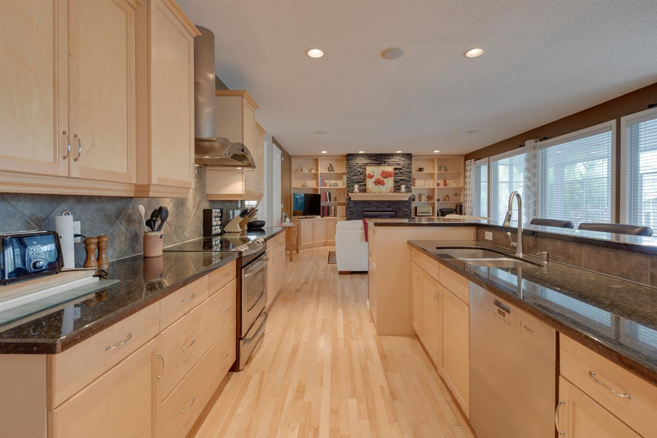 Huge kitchen with center island, granite counters and stainless steel appliances ??? a delight for any chef. Dinette is off this area PLUS there is a formal dining area.