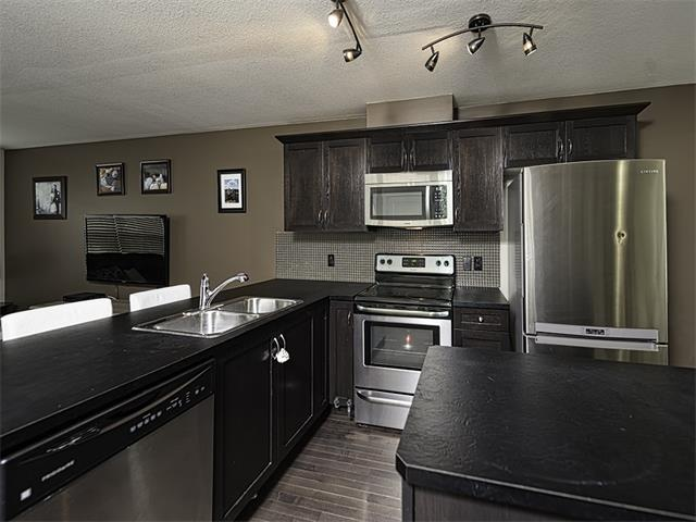 Photo 3: 249 Rainbow Falls Manor: Chestermere House for sale : MLS(r) # C4067433