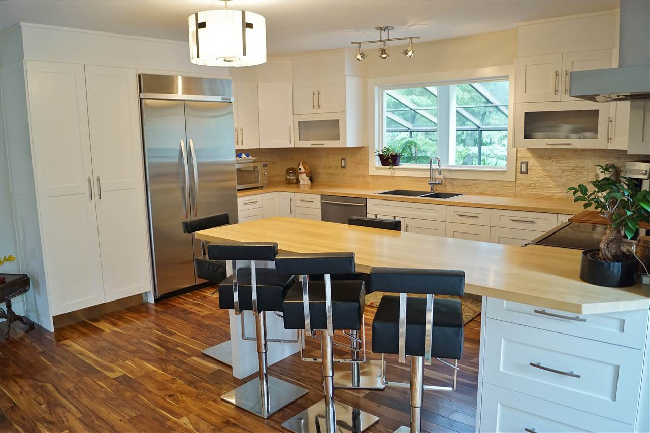 14) Modern white kitchen set off by stainless steel appliances
