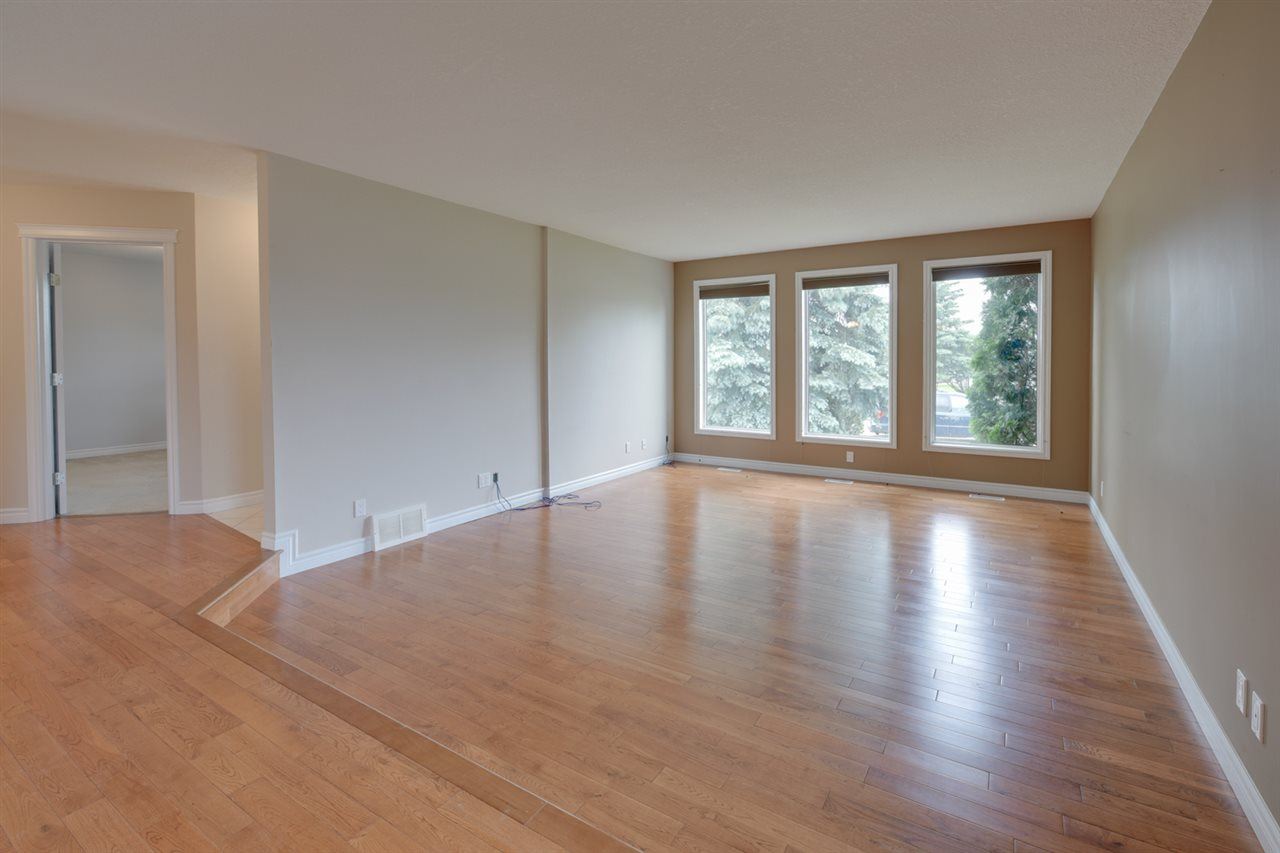 Huge Bright Front room with beautiful hardwood and big windows with blinds