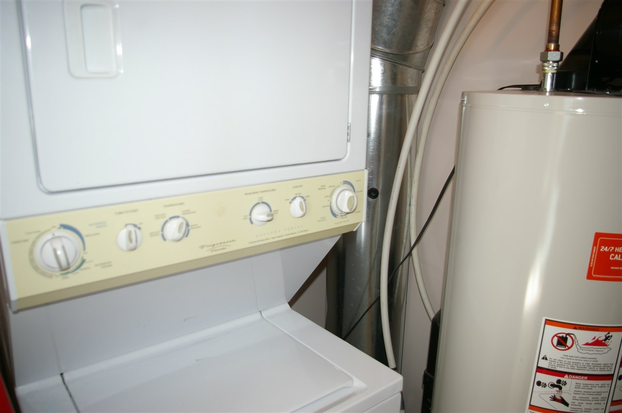 Washer and dryer are in the utility room, just off the living room