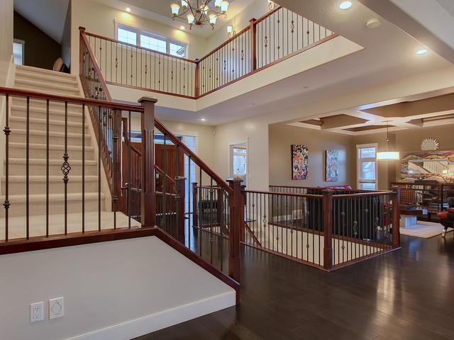 Open maple staircase with iron accent ascend to the Master Bedroom and 3 add'l bedrooms and full 5pc. bathroom.