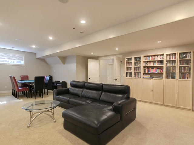 Open to games area. Built-in Cabinets and shelving. In-floor heating!
