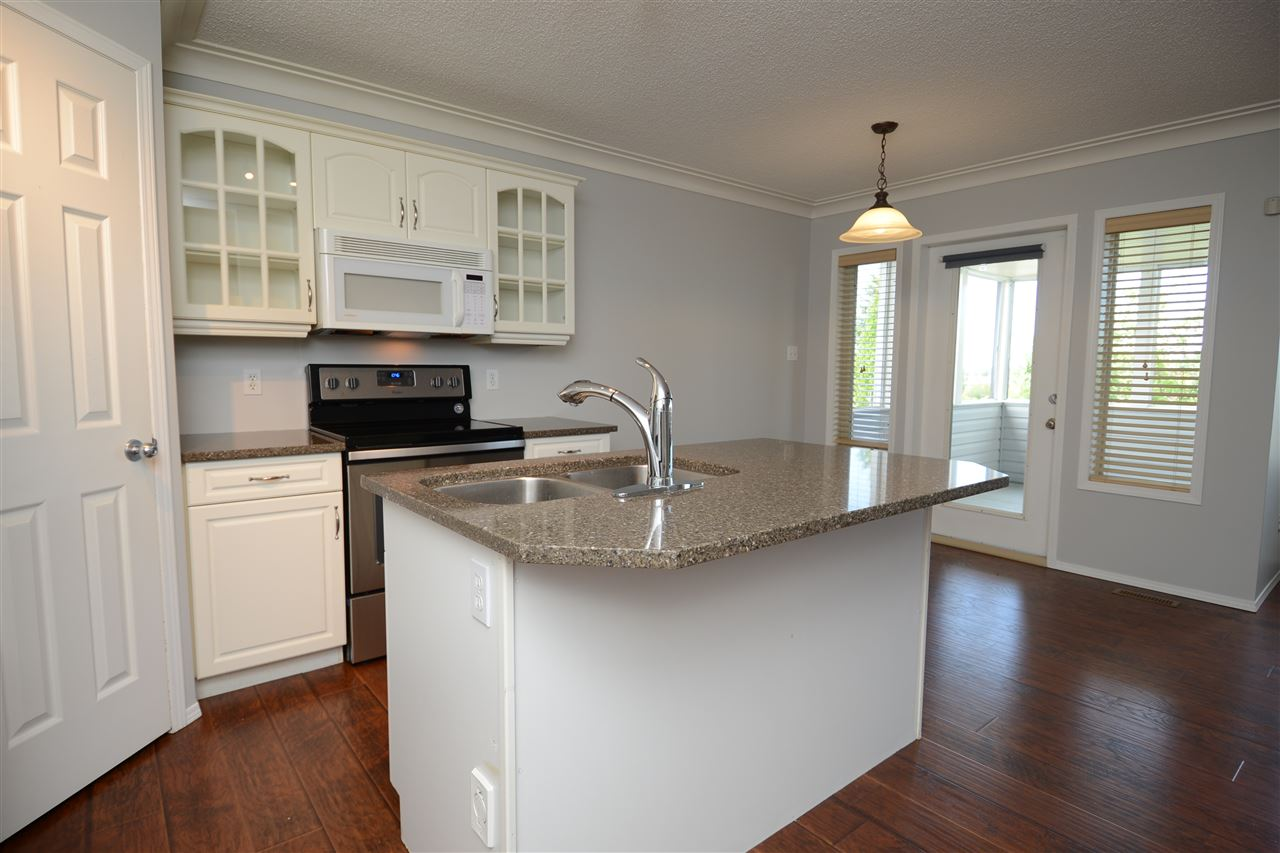 Freshly updated open kitchen w/ pantry, new stainless steel appliances, bright and sunny area of home.