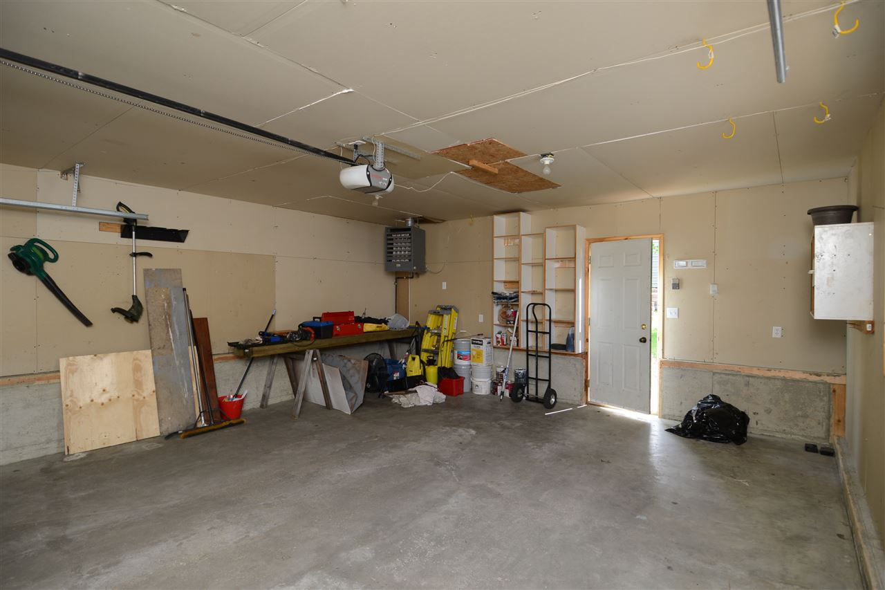 Heated (see Reznor heater in corner), double, detached garage. Parking on pad for another 2.