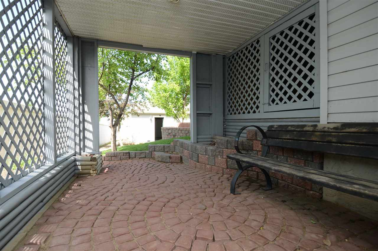 Basement Entry w/ covered patio area.