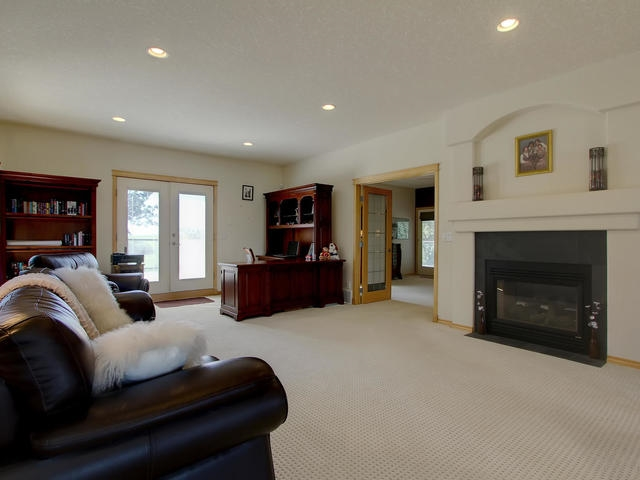 With two-sided gas fireplace, with French doors access to the patio area.