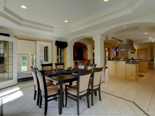 opens to the kitchen and with access to the patio and to the sunroom with sunk hot tub.