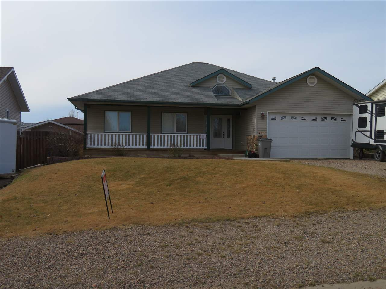 Custom built home on one level with fully fenced yard and facing greenspace.