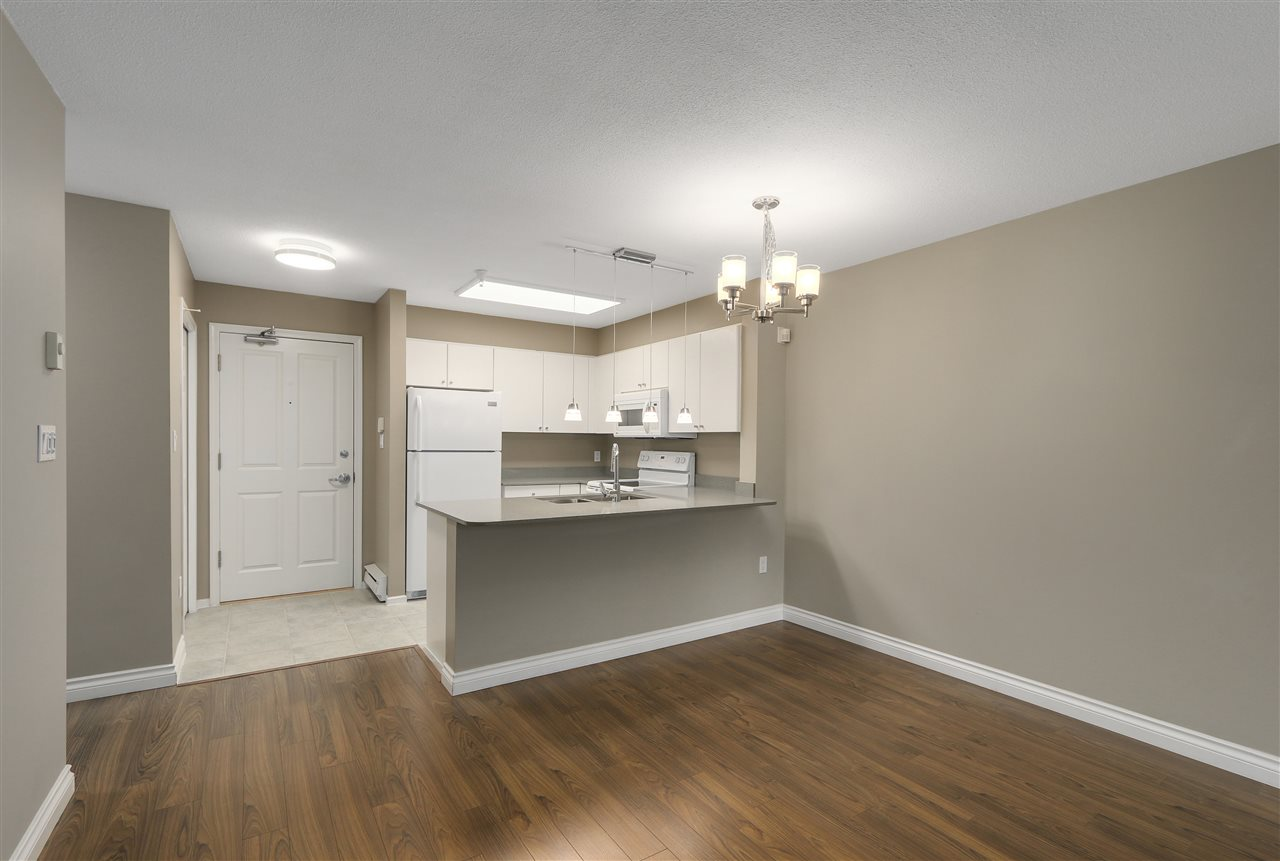 "Photo 5: 311 260 NEWPORT Drive in Port Moody: North Shore Pt Moody Condo for sale in ""MCNAIR"" : MLS(r) # R2125780"
