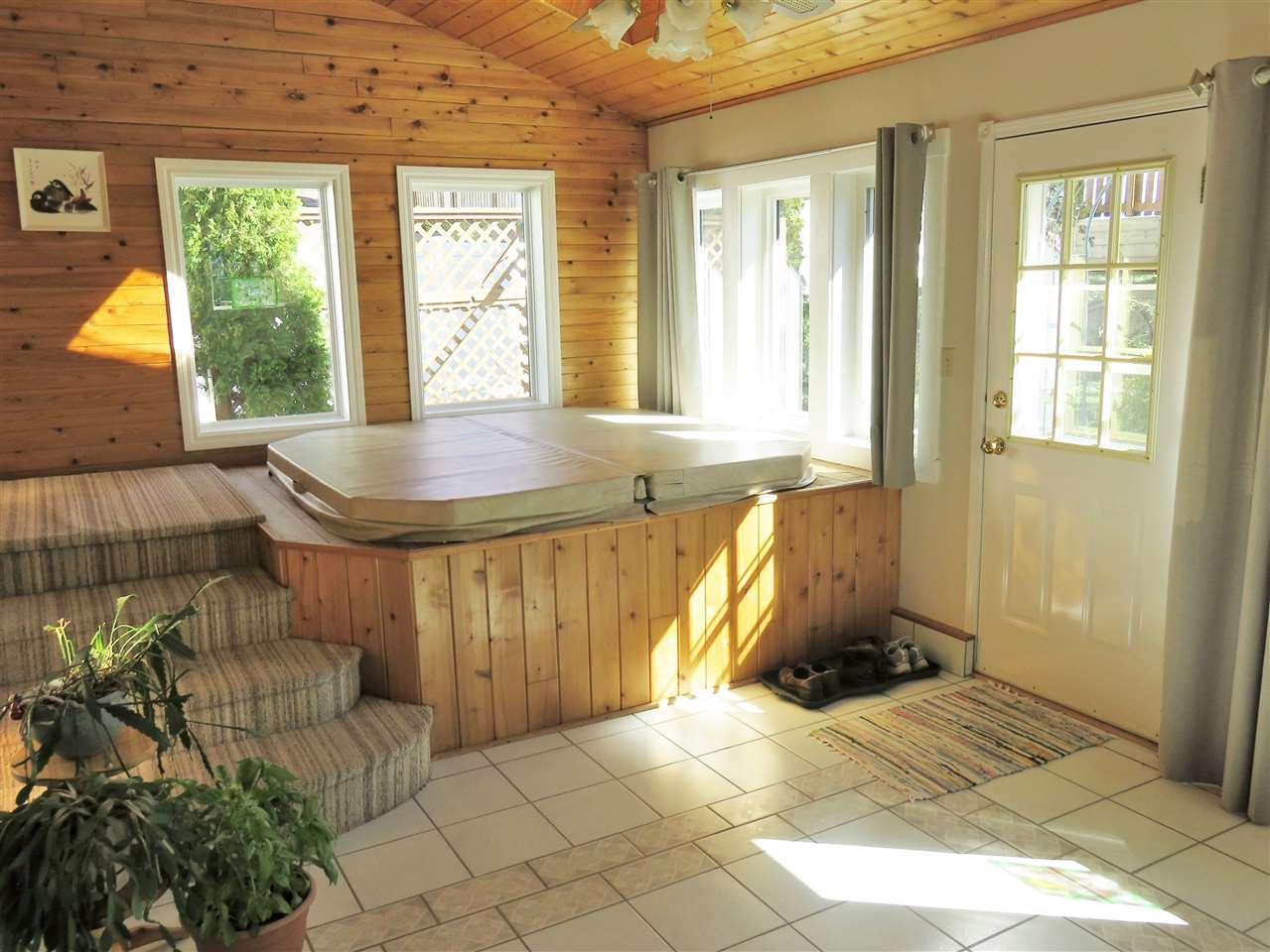 View of the Lower Level SUNROOM with the HOT TUB! :)