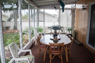 A beautiful 3 Season Sunroom with entrance off the main floor family room.